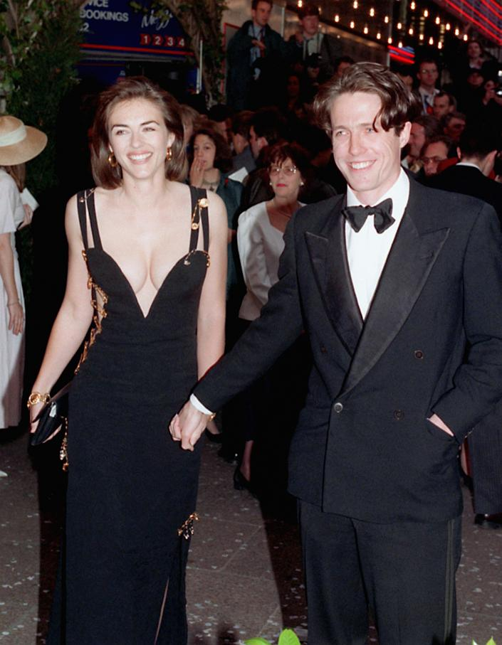 """Elizabeth Hurley and Hugh Grant, pictured at the 1994 film premiere of """"Four Weddings and a Funeral,"""" dated for 13 years. (Photo: Michael Stephens - PA Images/PA Images via Getty Images)"""