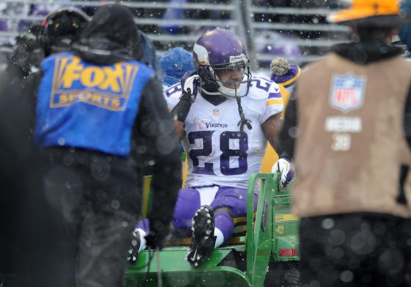 Minnesota Vikings running back Adrian Peterson is carted off the field after injuring his ankle on a play in the second quarter of an NFL football game against the Baltimore Ravens, Sunday, Dec. 8, 2013, in Baltimore. (AP Photo/Gail Burton)