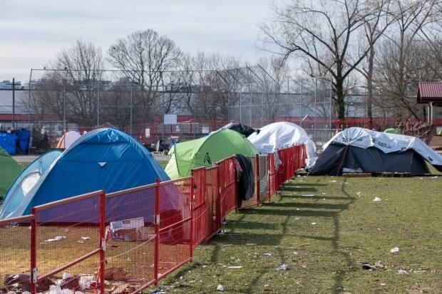 A newly installed fence around temporary homeless shelters at Strathcona Park in Vancouver, British Columbia on Friday, Feb. 12, 2021.  (Ben Nelms/CBC - image credit)