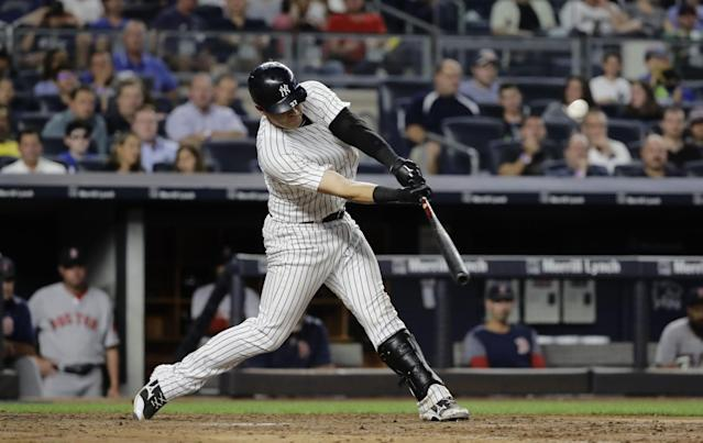 <p>New York Yankees' Austin Romine (27) hits an RBI-triple during the fifth inning of a baseball game against the Boston Red Sox, Sunday, Aug. 13, 2017, in New York. (AP Photo/Frank Franklin II) </p>