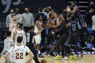 Sacramento Kings forward Harrison Barnes, facing right, is congratulated by teammates after shooting the game-winning 3-point basket during the second half of the team' NBA basketball game against the Cleveland Cavaliers in Sacramento, Calif., Saturday, March 27, 2021. (AP Photo/Jeff Chiu)