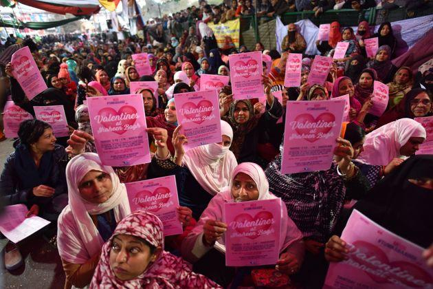 Women hold Valentines Day placards during a sit in protest against CAA, NRC and NPR at Shaheen Bagh on February 13, 2020. They have appealed to Prime Minister Narendra Modi to come and talk to them.