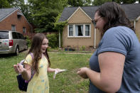 Abby Norman talks with her 9-year-old daughter Priscilla after she arrived home from school to the family's Decatur, Ga., home on Tuesday, May 18, 2021. Priscilla was in tears the first morning of testing because she felt pressure to do well, but didn't feel prepared after remote learning. (AP Photo/Ben Gray)