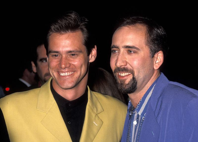 "Actor/Comedian Jim Carrey and actor Nicolas Cage attend the ""It Could Happen to You"" New York City Premiere on July 26, 1994 at the Paris Theatre in New York City. (Photo by Ron Galella, Ltd./Ron Galella Collection via Getty Images)"