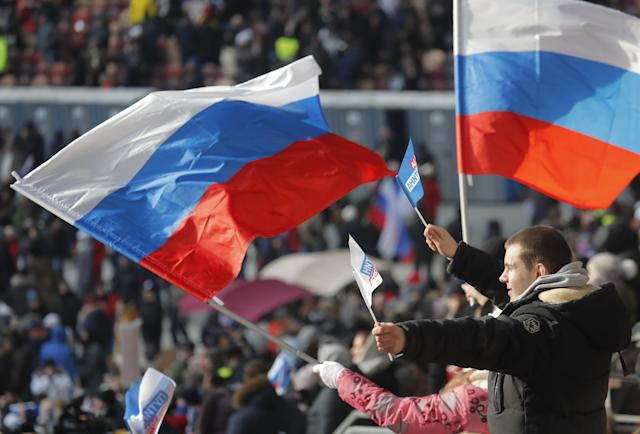 <p>People take part in a rally to support Russian President Vladimir Putin in the upcoming presidential election at Luzhniki Stadium in Moscow, Russia, March 3, 2018. (Photo: Maxim Shemetov/Reuters) </p>