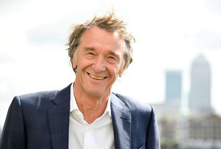 FILE PHOTO: Jim Ratcliffe, CEO of British petrochemicals company INEOS, poses for a portrait with the Canary Wharf financial district seen behind, ahead of a news conference announcing the launch of a British America's Cup sailing team in London, Britain, April 26, 2018. REUTERS/Toby Melville