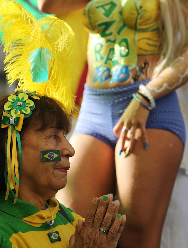Soccer Football - World Cup Group E - Brazil vs Costa Rica - Rio de Janeiro, Brazil - June 22, 2018 - A Fan reacts during the match as she watches the broadcast. REUTERS/Sergio Moraes