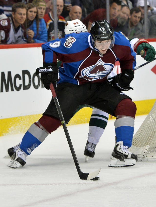 Colorado Avalanche center Matt Duchene (9) skates against Minnesota Wild center Mikael Granlund of Finland in the third period during Game 7 of an NHL hockey first-round playoff series on Wednesday, April 30, 2014, in Denver. (AP Photo/Jack Dempsey)