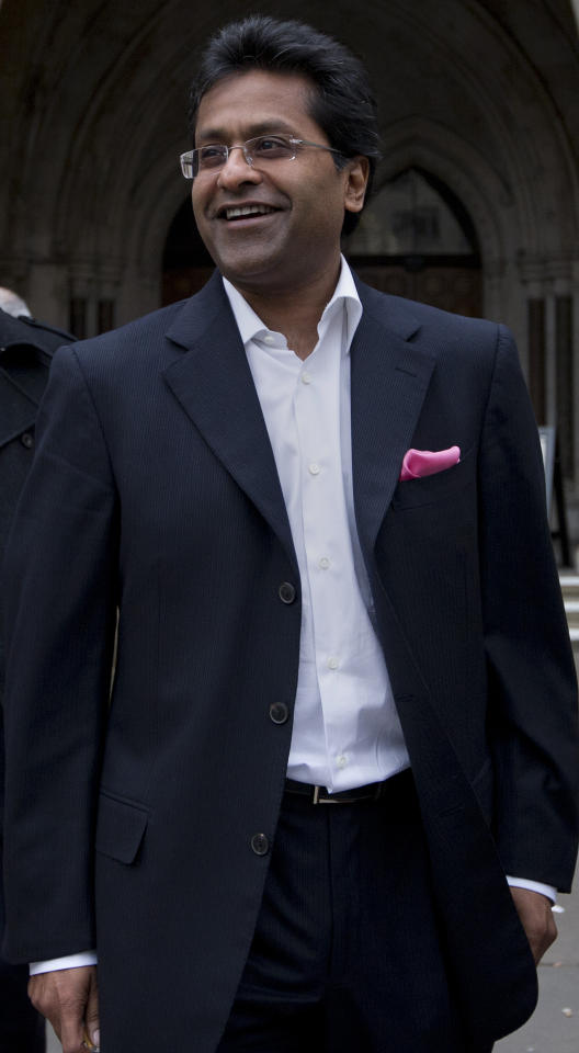 "Ex-chairman of India's cricket IPL, Lalit Modi, leaves the High Court in central London on March 5, 2012, after a hearing in a libel case brought against him by Former New Zealand cricket captain Chris Cairns. Cairns told the High Court in London on Monday that an accusation of match-fixing had reduced his career to ""dust"" and strained his marriage.   Cairns, 41, is suing Lalit Modi, the former chairman of Twenty20 franchise the Indian Premier League (IPL), for substantial libel damages over an ""unequivocal allegation"" made on Twitter. AFP PHOTO / CARL COURT (Photo credit should read CARL COURT/AFP/Getty Images)"