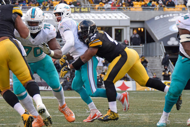 FILE - In this Jan. 8, 2017, file photo, Pittsburgh Steelers outside linebacker James Harrison (92) sacks Miami Dolphins quarterback Matt Moore (8), forcing a fumble that was recovered by the Steelers during the first half of an AFC Wild Card NFL football game in Pittsburgh. Longtime Steelers linebacker James Harrison is taking a second crack at retirement. The five-time Pro Bowler and 2008 NFL Defensive Player of the Year announced on Instagram early Monday, April 16, 2018, that he is stepping away from the game following a 15-year career. (AP Photo/Don Wright, File)