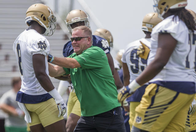 """<a class=""""link rapid-noclick-resp"""" href=""""/pga/players/6365/"""" data-ylk=""""slk:Brian Kelly"""">Brian Kelly</a> and Notre Dame are looking to rebound from a miserable 4-8 season. (Robert Franklin/South Bend Tribune via AP)"""