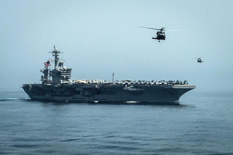 Handout picture released by the US Navy Media Content Services shows helicopters flying from the US aircraft carrier USS Theodore Roosevelt on April 13, 2015 in the Gulf of Oman (AFP Photo/Scott Fenaroli)