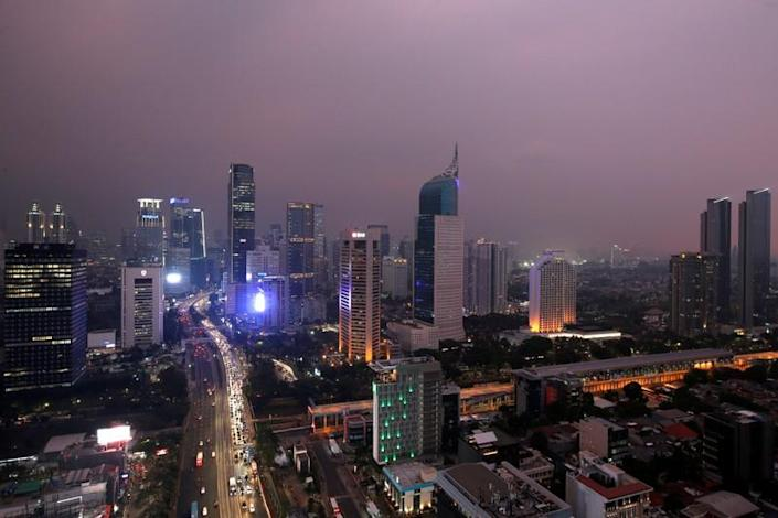 FILE PHOTO: General view of a business district at sunset in Jakarta