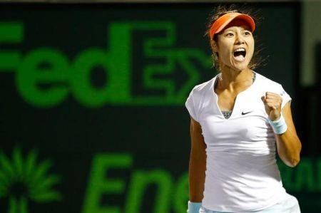Mar 26, 2014; Miami, FL, USA; Li Na celebrates after her match against Caroline Wozniacki (not pictured) on day ten of the Sony Open at Crandon Tennis Center. Na won 7-5, 7-5. Mandatory Credit: Geoff Burke-USA TODAY Sports