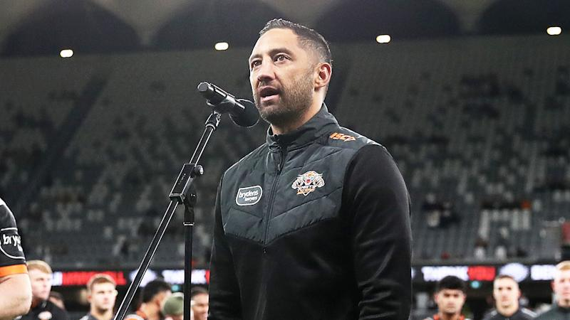 Benji Marshall (pictured) speaks to the crowd after playing in his last game for the Tigers.