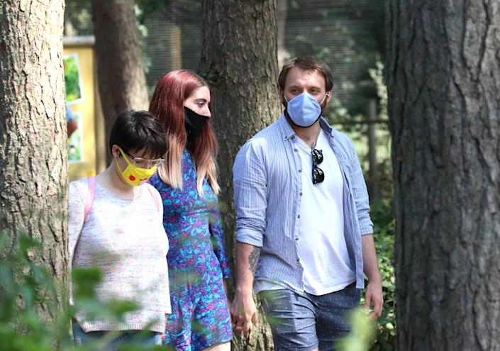 Three people walk in the woods wearing protective face masks as a precaution. Daily life in Yorkshire, the largest county in England, UK. (Photo by Keith Mayhew / SOPA Images/Sipa USA)