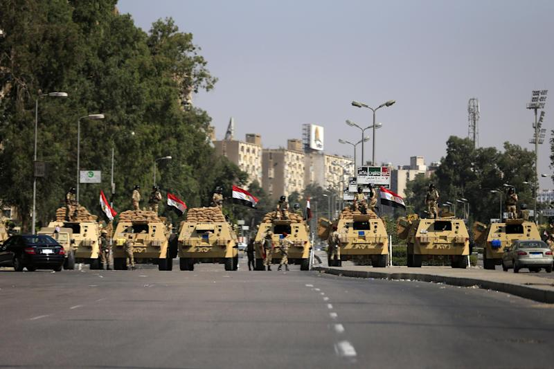 Egyptian soldiers secure the area around Nasser City, where Muslim Brotherhood supporters have gathered to support ousted president Mohammed Morsi, in Cairo Thursday, July 4, 2013. Adly Mansour, the chief justice of Egypt's Supreme Constitutional Court, was sworn in Thursday as the nation's interim president, taking over hours after the military ousted Morsi. According to military decree, Mansour will serve as Egypt's interim leader until a new president is elected. A date for that vote has yet to be set. (AP Photo/Hassan Ammar)