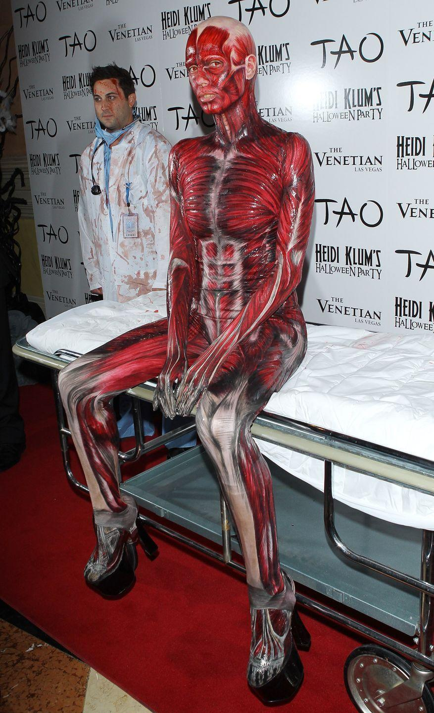 <p>Celebrating Bodyworlds - the exhibition that toured the world featuring preserved cadavars - Heidi dressed up as a dead body on a gurney. </p><p>Well, it's one way to travel to a party. </p>