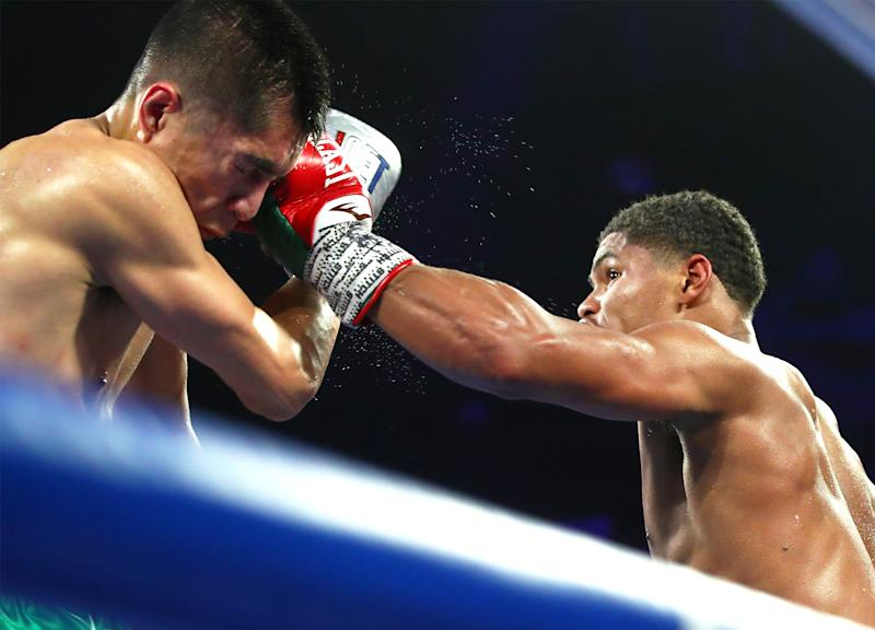 Shakur Stevenson (R) lands a punch vs. Joet Stevenson during their WBO featherweight world title fight at the Atlantis Casino Resort Spa in Reno, Nevada. (Mikey Williams/Top Rank)