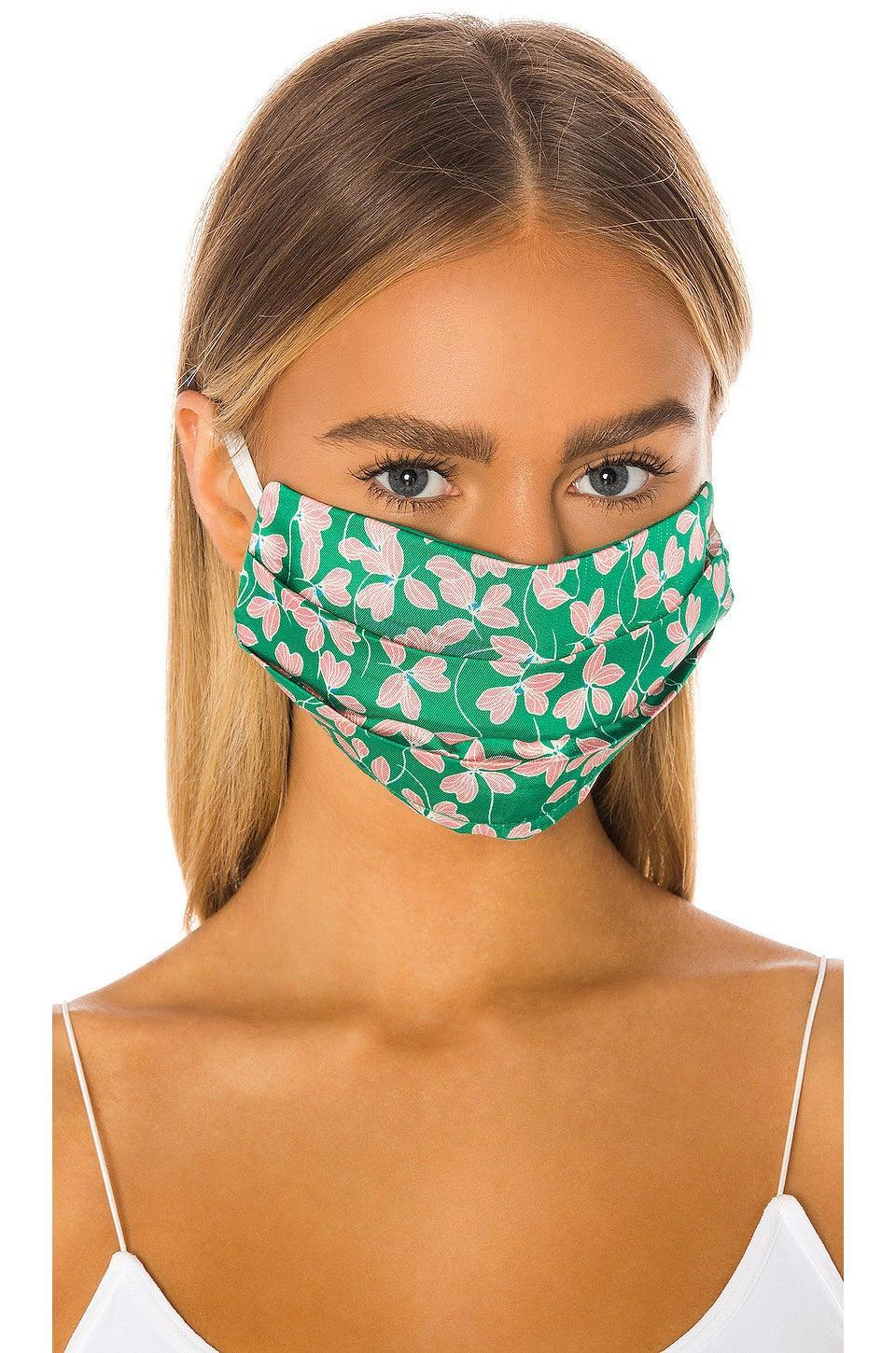 """<h3><a href=""""https://fave.co/2SDMt3u"""" rel=""""nofollow noopener"""" target=""""_blank"""" data-ylk=""""slk:Karina Grimaldi Amanda Face Mask"""" class=""""link rapid-noclick-resp"""">Karina Grimaldi Amanda Face Mask</a></h3> <br>Also available for pre-order on Revolve are double-layered face masks with a viscose satin-twill overlay by Karina Grimald. The estimated delivery date for this style is May 18, and the red and green floating leaf motif feels like it's fresh off a tropical island — where you'll find us mentally residing for the remainder of the week. <br><br><strong>Karina Grimaldi</strong> Amanda Face Mask, $, available at <a href=""""https://go.skimresources.com/?id=30283X879131&url=https%3A%2F%2Ffave.co%2F2SDMt3u"""" rel=""""nofollow noopener"""" target=""""_blank"""" data-ylk=""""slk:Revolve"""" class=""""link rapid-noclick-resp"""">Revolve</a><br>"""