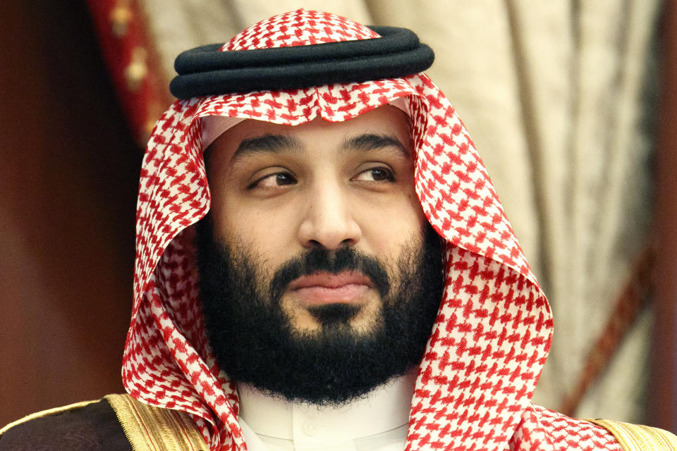 FILE - In this Monday, June 24, 2019 file photo, Saudi Arabia's Crown Prince Mohammed bin Salman meets with Secretary of State Mike Pompeo at Al Salam Palace in Jeddah, Saudi Arabia. English Premier League club Newcastle was taken over by Saudi Arabia's sovereign wealth fund on Thursday, Oct. 7, 2021 after a protracted takeover. The takeover by the Saudi Public Investment Fund initially collapsed last year over concerns about how much control the kingdom's leadership would have in the running of Newcastle amid concerns about Saudi human rights abuses and the pirating of sports rights. (AP Photo/Jacquelyn Martin, Pool, File)