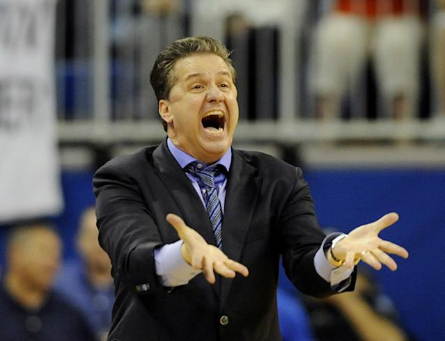 Kentucky coach John Calipari reacts to a play during an NCAA college basketball game against Florida Saturday, March 8, 2014, in Gainesville, Fla. Florida won the game 84-65. (AP Photo/Phil Sandlin)