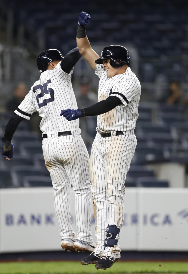 New York Yankees' Gleyber Torres (25) celebrates with Gio Urshela after scoring on Urshela's game-tying, two-run home run during the ninth inning of the team's baseball game against the Seattle Mariners, Tuesday, May 7, 2019, in New York. The Yankees won 5-4. (AP Photo/Kathy Willens)