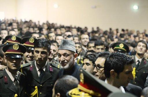 Afghan army officers with President Hamir Karzai (centre) at the National Miltary Academy in Kabul on February 16, 2013