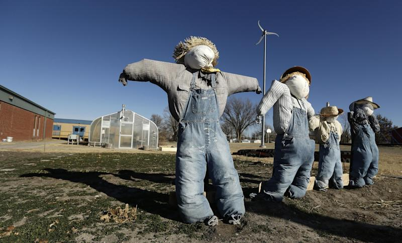 In this Thursday, Dec. 12, 2013 photo, scarecrows stand in a dormant garden at the Walton 21st Century Rural Life Center in Walton, Kan. Located in a small farming community, the school faced closing before re-establishing itself as an agriculture-focused charter school and more than doubling enrollment. (AP Photo/Charlie Riedel)