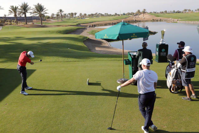 Germany's Martin Kaymer, left, tees off on the first hole during the final round of the Saudi International at Royal Greens Golf and Country Club, Sunday, Feb. 2, 2020, in Red Sea resort of King Abdullah Economic City, Saudi Arabia. (AP Photo/Amr Nabil)