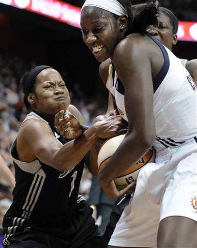 San Antonio Silver Stars' Jia Perkins, left, scramble with Connecticut Sun's Tina Charles for possession of the ball during the first half of a WNBA basketball game in Uncasville, Conn., Sunday, July 14, 2013. (AP Photo/Jessica Hill)