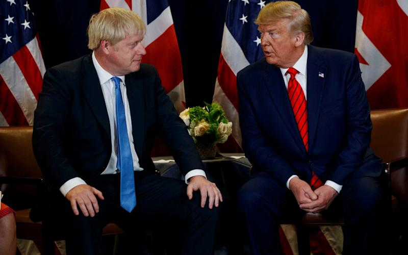 President Donald Trump meets with British Prime Minister Boris Johnson at the United Nations General Assembly in New York - AP