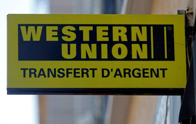 FILE PHOTO: The logo of a Western Union money transfer point is seen in Marseille