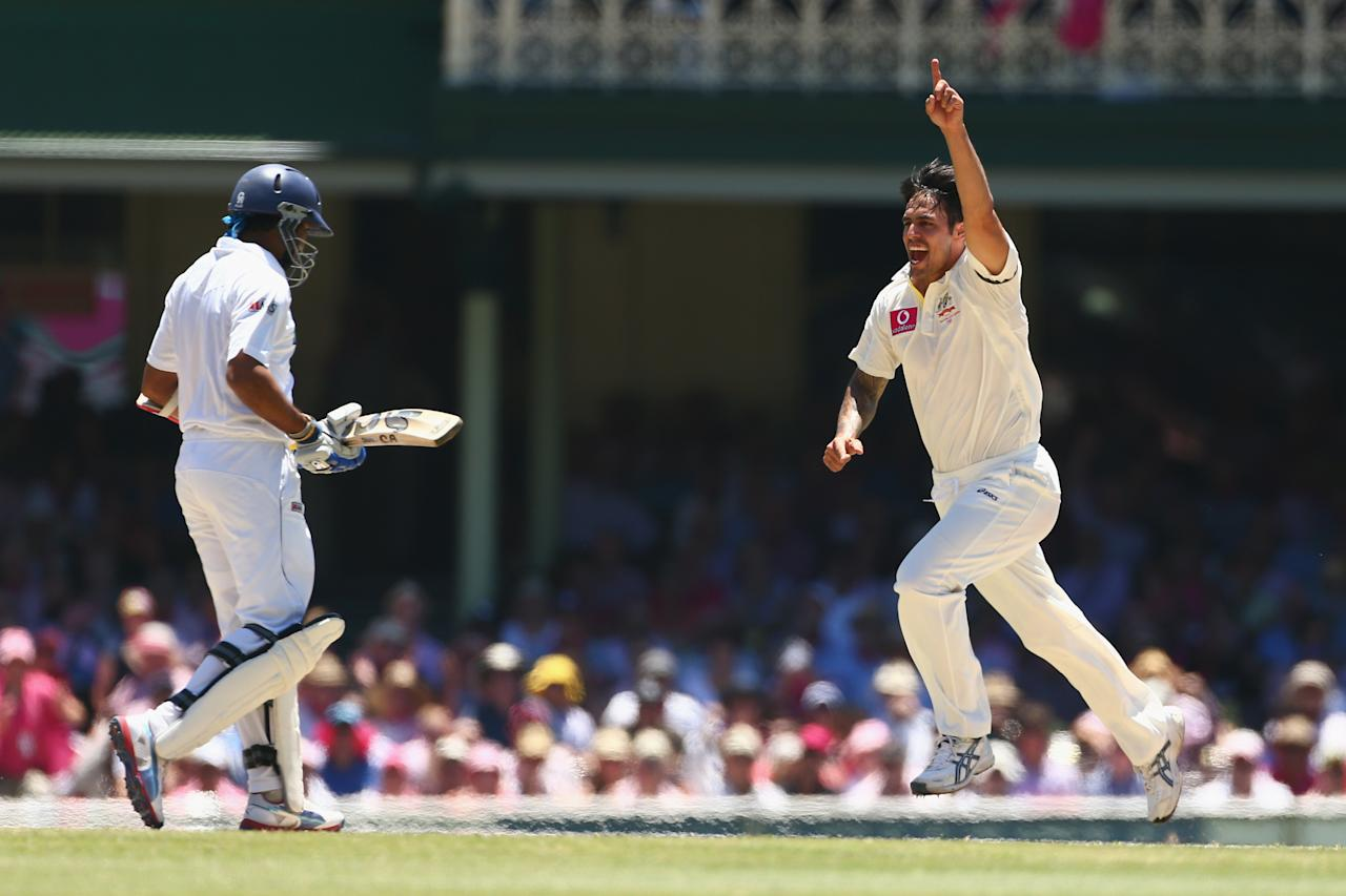 SYDNEY, AUSTRALIA - JANUARY 05:  Mitchell Johnson of Australia celebrates taking the wicket of Tillakaratne Dilshan of Sri Lanka during day three of the Third Test match between Australia and Sri Lanka at Sydney Cricket Ground on January 5, 2013 in Sydney, Australia.  (Photo by Mark Kolbe/Getty Images)