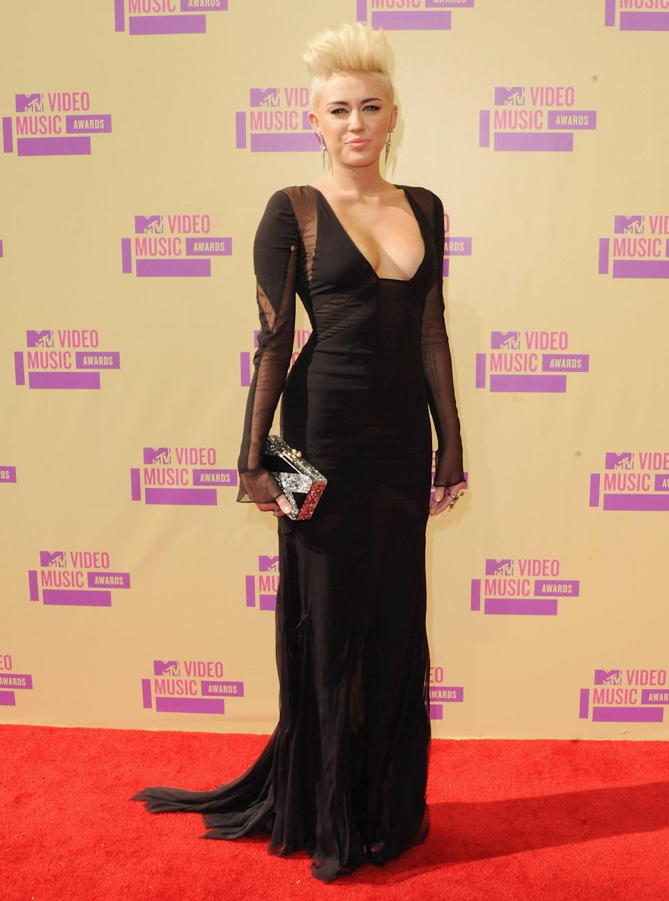 Miley Cyrus slipped on one of her most elegant looks ever in Emilio Pucci, accented with a platinum blonde mohawk.