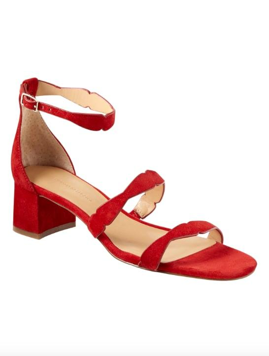 """<p>Go with the soft and vibrant red suede of this <a href=""""https://www.popsugar.com/buy/Laser-Cut-Low-Block-Heel-Sandal-536124?p_name=Laser-Cut%20Low%20Block-Heel%20Sandal&retailer=bananarepublic.gap.com&pid=536124&price=75&evar1=fab%3Aus&evar9=47052447&evar98=https%3A%2F%2Fwww.popsugar.com%2Fphoto-gallery%2F47052447%2Fimage%2F47052452%2FLaser-Cut-Low-Block-Heel-Sandal&list1=banana%20republic%2Cshoes%2Cfashion%20shopping&prop13=api&pdata=1"""" rel=""""nofollow"""" data-shoppable-link=""""1"""" target=""""_blank"""" class=""""ga-track"""" data-ga-category=""""Related"""" data-ga-label=""""http://bananarepublic.gap.com/browse/product.do?pid=266925012&amp;cid=1035406&amp;pcid=1027224&amp;vid=1&amp;grid=pds_54_63_1#pdp-page-content"""" data-ga-action=""""In-Line Links"""">Laser-Cut Low Block-Heel Sandal</a> ($75) when you want to add some colorful detail to a neutral outfit, but also want to keep your feet comfy all day. </p>"""