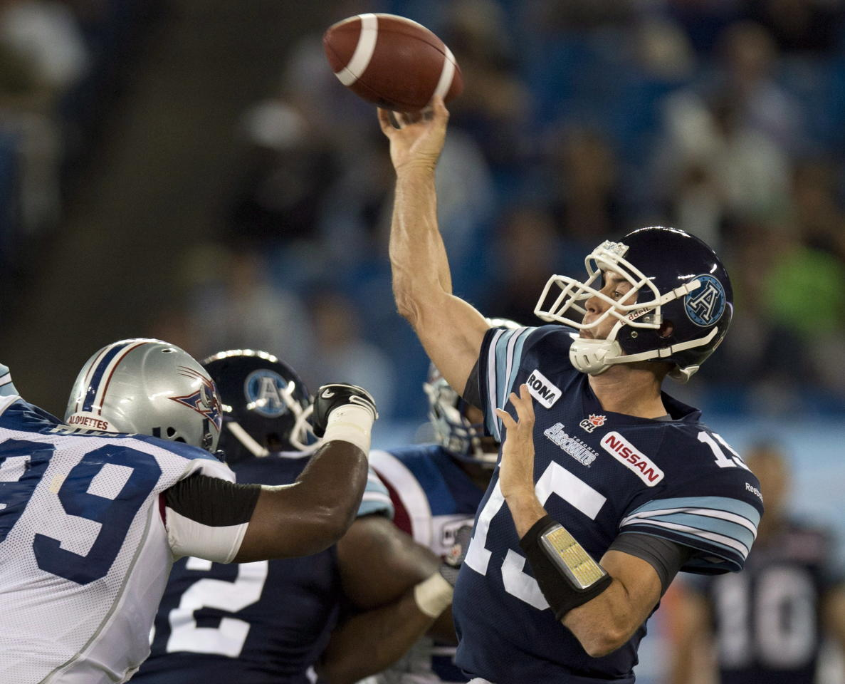 Toronto Argonauts quarterback Ricky Ray (15) throws against the Montreal Alouettes during first half CFL pre-season action in Toronto on Tuesday June 19, 2012. THE CANADIAN PRESS/FRANK GUNN