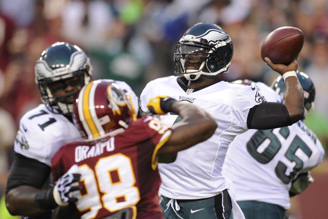 Philadelphia Eagles quarterback Michael Vick throws under pressure from Washington Redskins outside linebacker Brian Orakpo during the first half of an NFL football game in Landover, Md., Monday, Sept. 9, 2013. (AP Photo/Nick Wass)