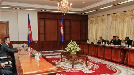 Cambodian PM Hun Sen speaks with Sam Rainsy, president of CNRP, during a meeting at Cambodia's National assembly in central Phnom Penh