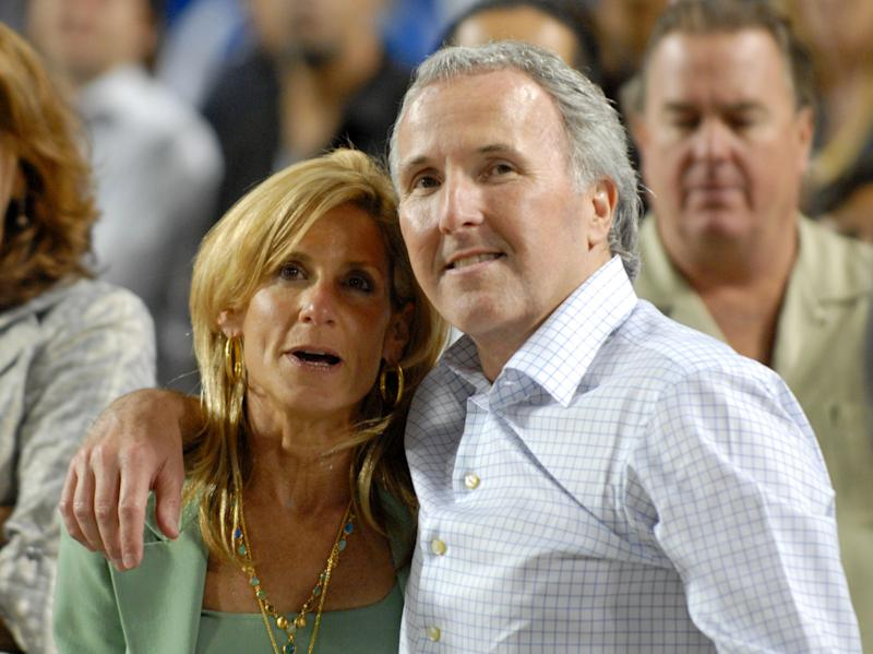 FILE - In this Sept. 25, 2008 photo, Los Angeles Dodgers owner and chairman Frank McCourt and his wife Jamie McCourt after the Dodgers' baseball game against the San Diego Padres in Los Angeles. The ex-wife of former Los Angeles Dodgers owner Frank McCourt wants to set aside the couple's divorce settlement, claiming he vastly understated the value of a team that sold earlier this year for $2 billion, the highest figure ever paid for a pro sports franchise. The motion filed Monday Sept. 24, 2012 in Los Angeles Superior Court claims Frank McCourt committed fraud by misrepresenting the couple's Dodgers assets as worth less than $300 million during their protracted divorce.   (AP Photo/Carlos Delgado, File)