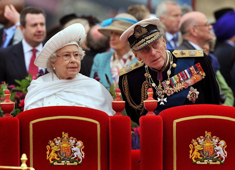 FILE - A Sunday June 3, 2012 photo from files showing Britain's Queen Elizabeth II, and her husband Prince Philip watching the proceedings from the royal barge during the Diamond Jubilee Pageant on the River Thames in London.  Buckingham Palace says Prince Philip, husband of Queen Elizabeth II, has been hospitalized with a bladder infection. The 90-year-old prince has been taking part in celebrations of the queen's Diamond Jubilee. (AP Photo/John Stillwell, Pool, File)