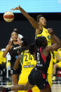 Seattle Storm center Mercedes Russell (2) blocks a shot by Las Vegas Aces guard Jackie Young (0) during the first half of Game 1 of basketball's WNBA Finals Friday, Oct. 2, 2020, in Bradenton, Fla. (AP Photo/Chris O'Meara)