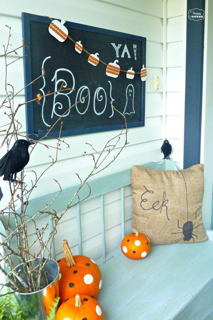 """<p>Not all Halloween decorations have to be scary, you know. This cheery porch combines bright colors, a fun chalkboard sign, and a few playful DIY elements for a result that's festive—but not scary.</p><p><strong>Get the tutorial at <a href=""""https://thehappyhousie.porch.com/halloween-house-tour-2/"""" rel=""""nofollow noopener"""" target=""""_blank"""" data-ylk=""""slk:The Happy Housie"""" class=""""link rapid-noclick-resp"""">The Happy Housie</a>.</strong></p><p><a class=""""link rapid-noclick-resp"""" href=""""https://go.redirectingat.com?id=74968X1596630&url=https%3A%2F%2Fwww.walmart.com%2Fip%2FRust-Oleum-Specialty-Black-Chalk-Board-Paint-30-fl-oz%2F17011098&sref=https%3A%2F%2Fwww.thepioneerwoman.com%2Fholidays-celebrations%2Fg32894423%2Foutdoor-halloween-decorations%2F"""" rel=""""nofollow noopener"""" target=""""_blank"""" data-ylk=""""slk:SHOP CHALKBOARD PAINT"""">SHOP CHALKBOARD PAINT </a></p>"""