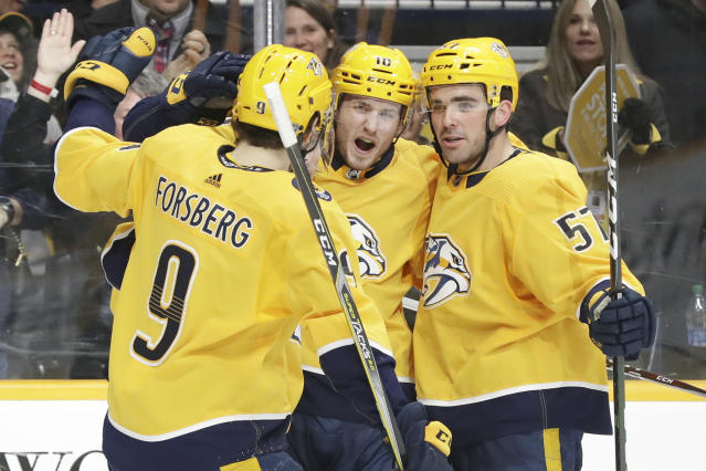 Nashville Predators center Colton Sissons (10) celebrates with Filip Forsberg (9), of Sweden, and Dante Fabbro (57) after Sissons scored a goal against the Columbus Blue Jackets in the second period of an NHL hockey game Saturday, Feb. 22, 2020, in Nashville, Tenn. (AP Photo/Mark Humphrey)