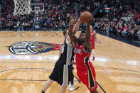 New Orleans Pelicans forward Zion Williamson (1) goes to the basket against San Antonio Spurs center Jakob Poeltl (25) in the second half of an NBA basketball game in New Orleans, Wednesday, Jan. 22, 2020. The Spurs won 121-117. (AP Photo/Gerald Herbert)