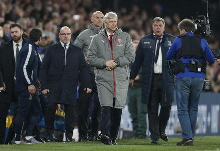 Arsenal manager Arsene Wenger looks dejected after the match