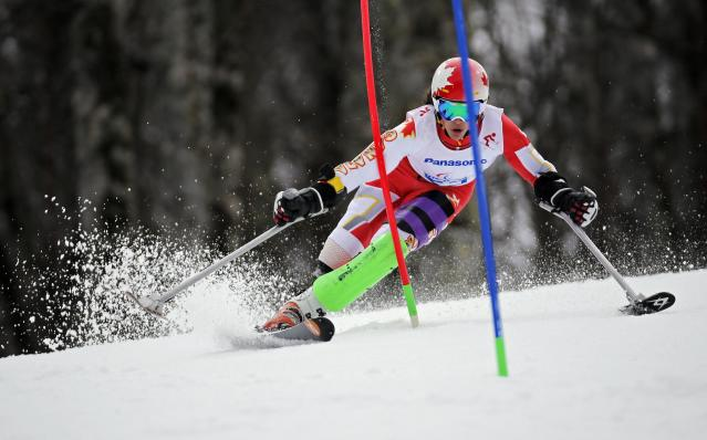 Canada's Braydon Luscombe skis during the Men's Visually Standing Slalom event at the 2014 Sochi Paralympic Winter Games at the Rosa Khutor Alpine Center, March 13, 2014. REUTERS/Christian Hartmann (RUSSIA - Tags: SPORT SKIING OLYMPICS)