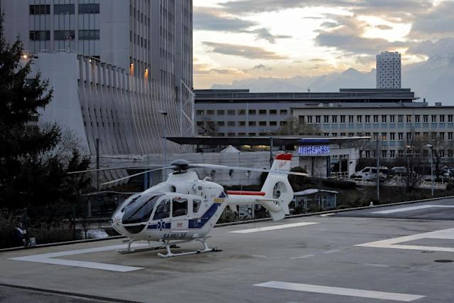"An helicopter is seen in front of the Grenoble hospital, in the French Alps, where former seven-time Formula One champion Michael Schumacher is treated after he sustained a head injury during a ski accident in Meribel France, Sunday, Dec. 29, 2013. The French Mountain Gendarmerie said Schumacher was wearing a helmet when he had a hard fall at Meribel and that he sustained a ""relatively serious"" head injury. He was initially taken to a local hospital and later transferred to a hospital in the city of Grenoble. (AP Photo/Laurent Cipriani)"