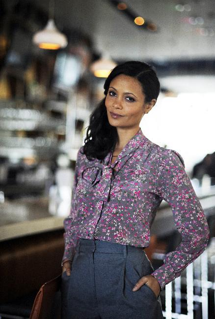 """In this Thursday, March 28, 2013 photo, actress Thandie Newton poses for a photograph, in Atlanta. Newton stars as a conflicted undercover cop in a new television crime series, """"Rouge,"""" airing April 3, 2013. (AP Photo/Mike Stewart)"""