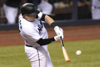 Miami Marlins' Chad Wallach hits a sacrifice fly to score Brian Anderson during the seventh inning of a baseball game against the Arizona Diamondbacks, Thursday, May 6, 2021, in Miami. (AP Photo/Lynne Sladky)